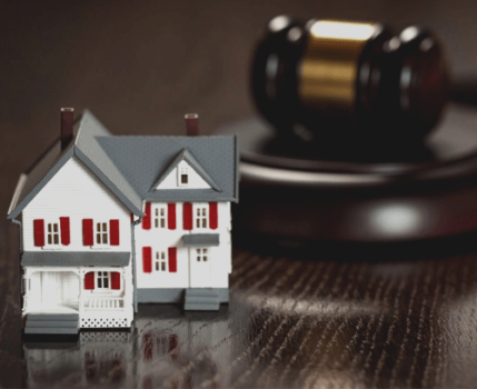 Small House Toy are shown with Gavel of Judge behind it