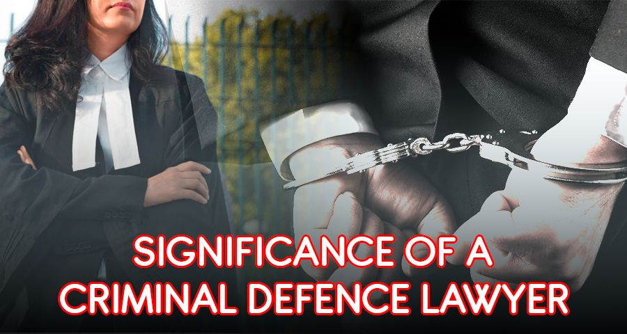 Criminal standing with hand in cuffs with criminal defence lawyer